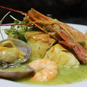 Supreme of Wreck Bass (Cherne) with a King Prawn, Clams and Prawns with Salsa verde